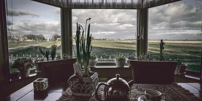 Schilderachtig uitzicht vanuit een woning tijdens een pastoraal bezoek. FOTO MAARTEN BOERSEMA
