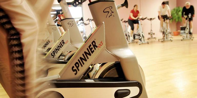 Spinning in de sportschool. FOTO ANP