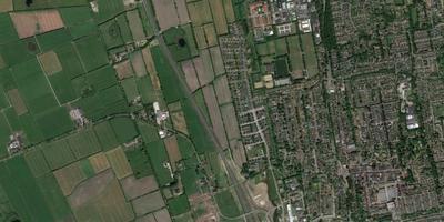 Luchtbeelden van Burgum, met rechts van de Sintrale As de onbebouwde percelen waar het om gaat. SCREENSHOT GOOGLE MAPS