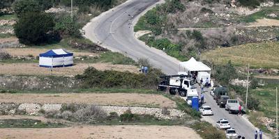 De plek waar de autobom ontplofte die een einde maakte aan het leven van de Maltese journaliste Daphne Caruana Galazia. FOTO ANP