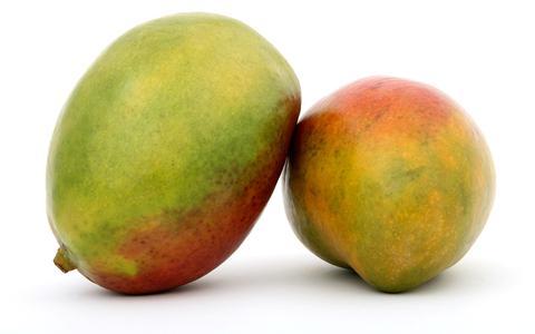 Oranjegeel, plakkerig en verleidelijk zoet. Hoe de mango de wereld heeft veroverd