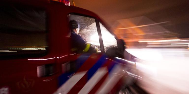 Brandweerman gewond na val bij blussen brand
