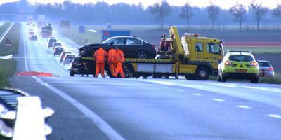 Vrouw komt om door ongeluk op gladde A6. FOTO ANP