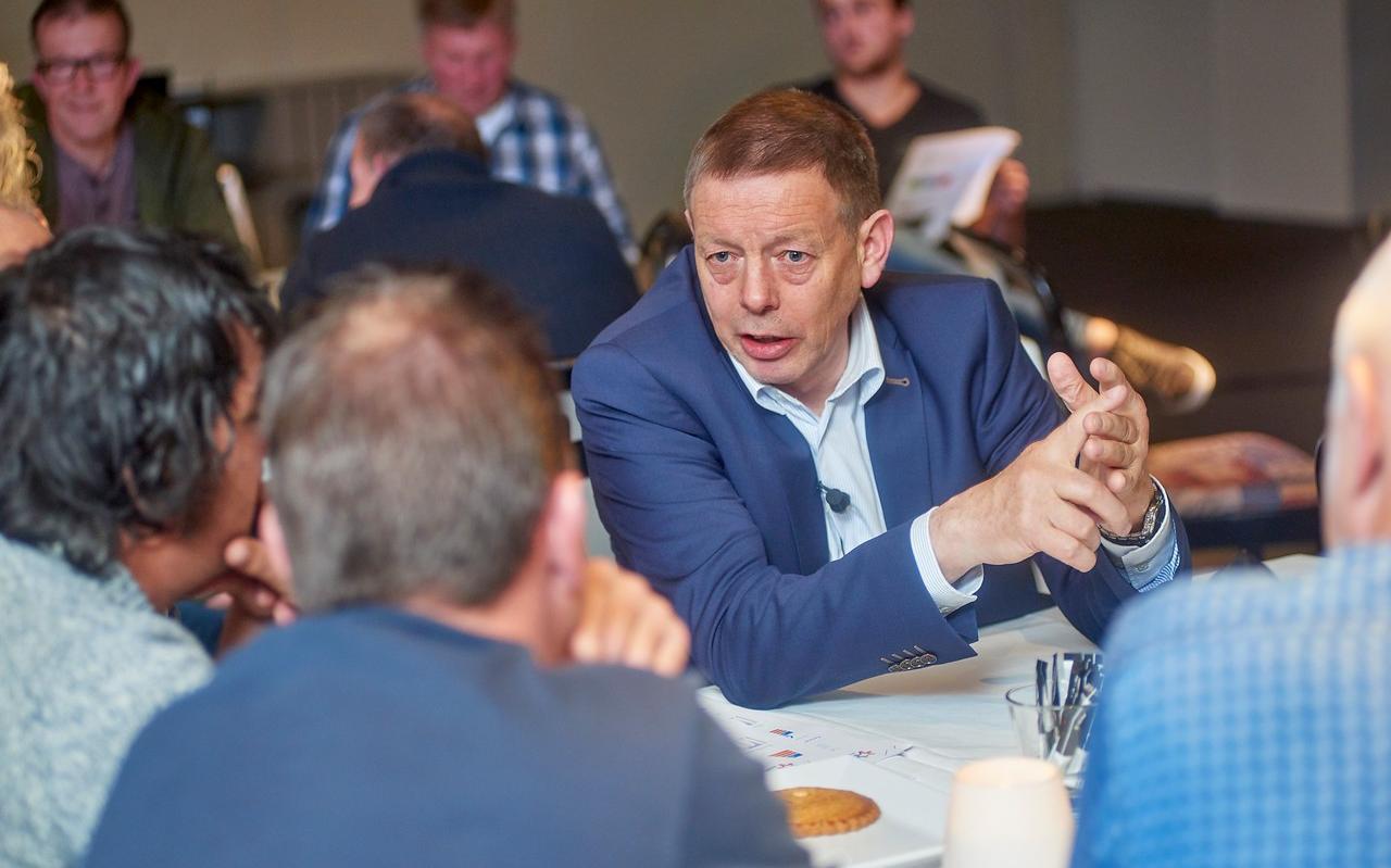Coöperatievoorzitter Frans Keurentjes tijdens een ledenvergadering van FrieslandCampina.