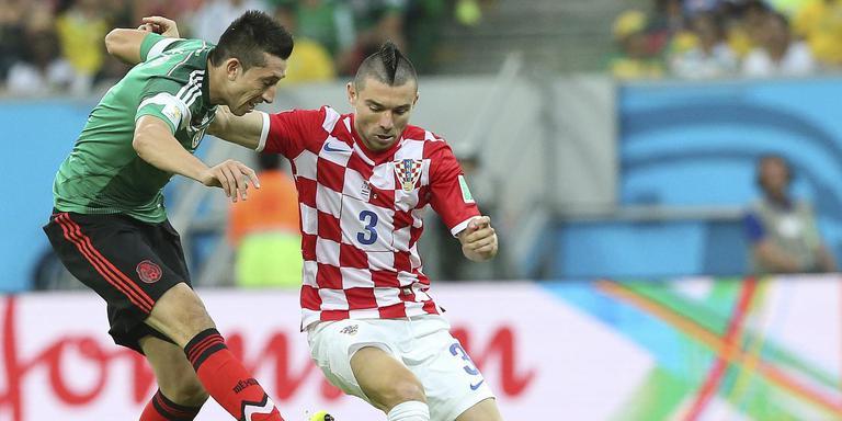Danijel Pranjic (r) namens Kroatië in actie tijdens het vorige WK. FOTO EPA